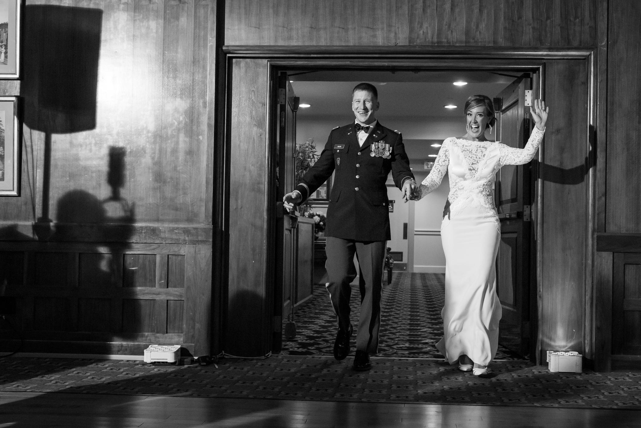 Stefy Hilmer Photography-bride and groom entering reception room.jpg