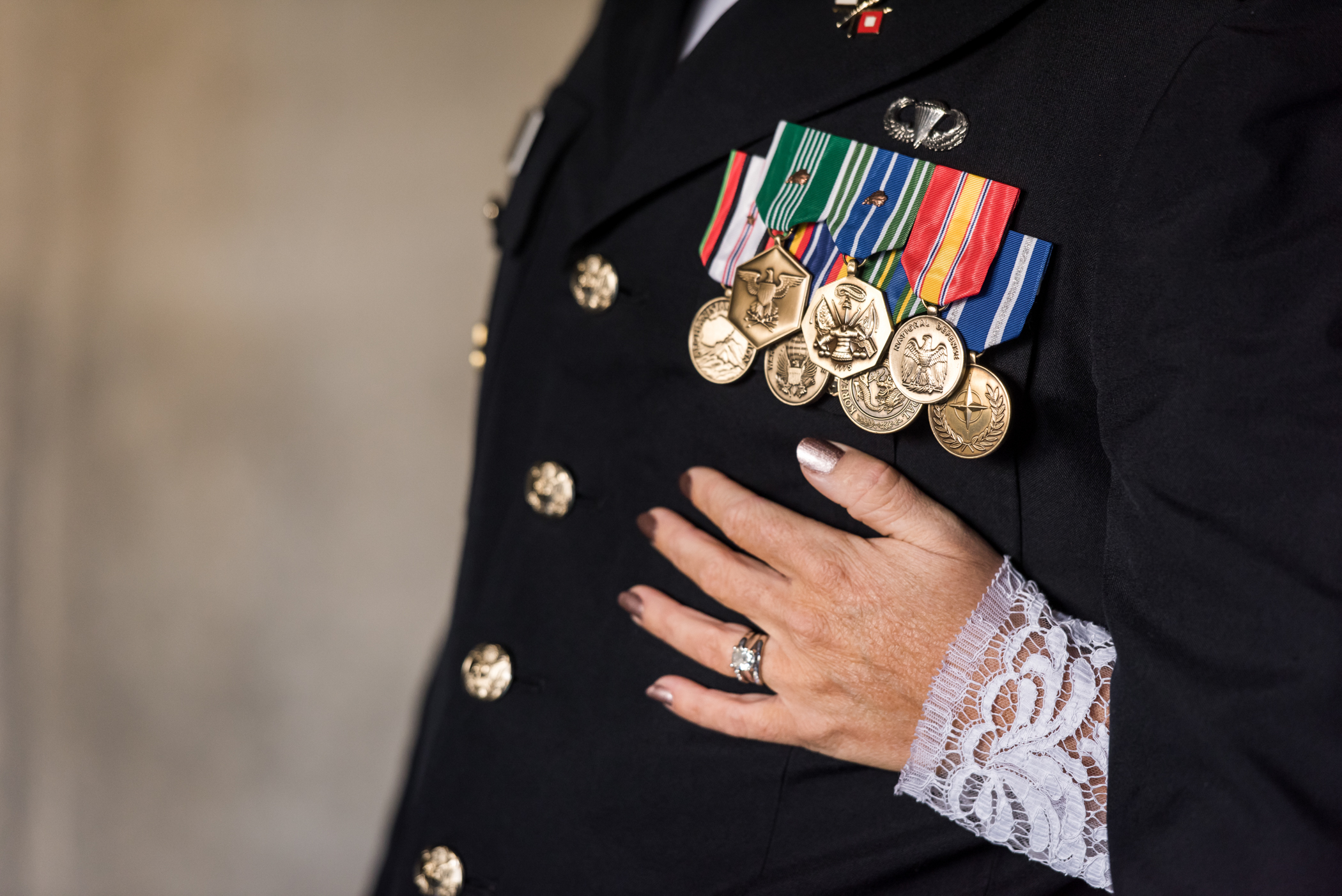 Stefy Hilmer Photography-bride hugging her husband showing military ranks.jpg