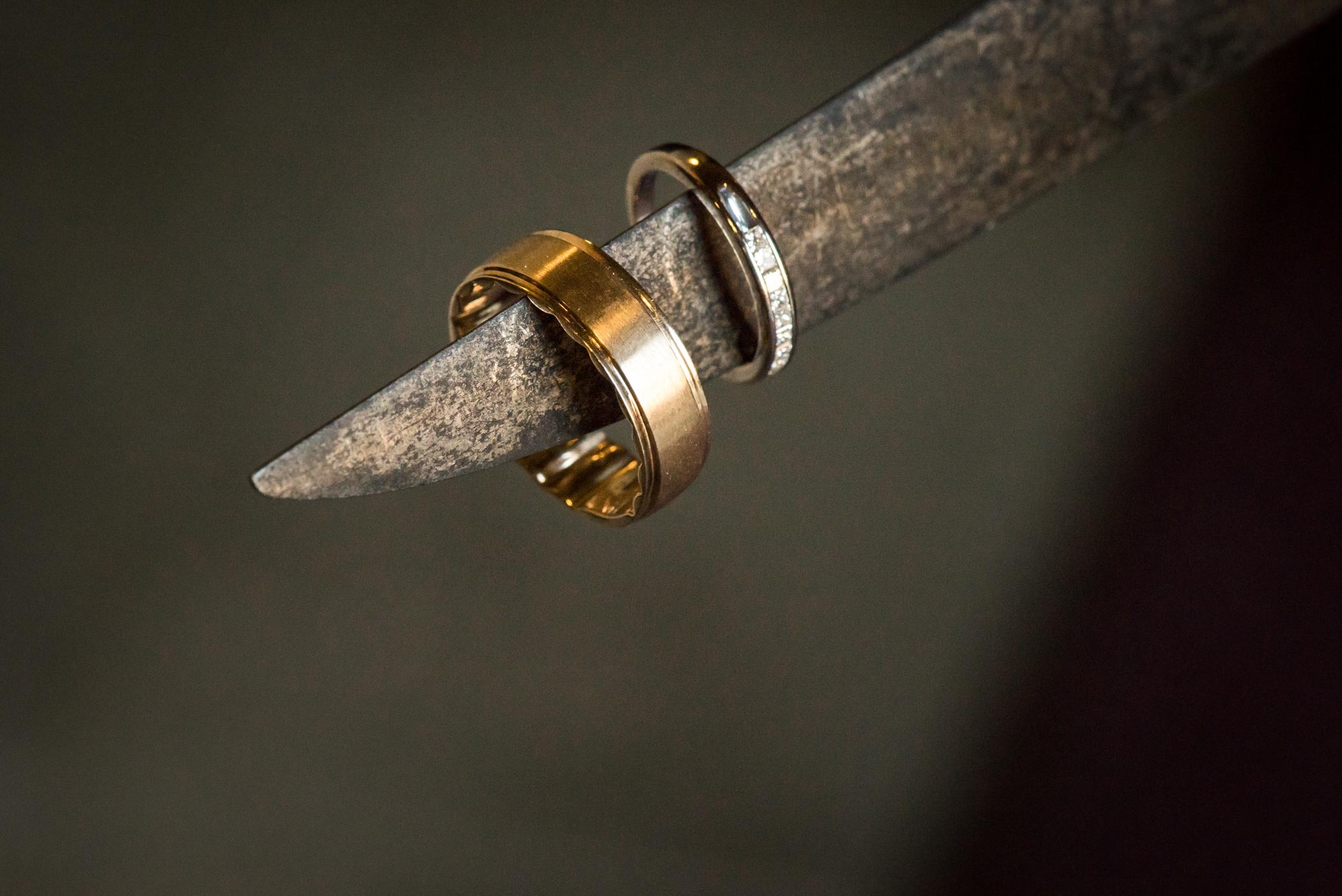 Stefy Hilmer Photography-wedding rings on the sword.jpg