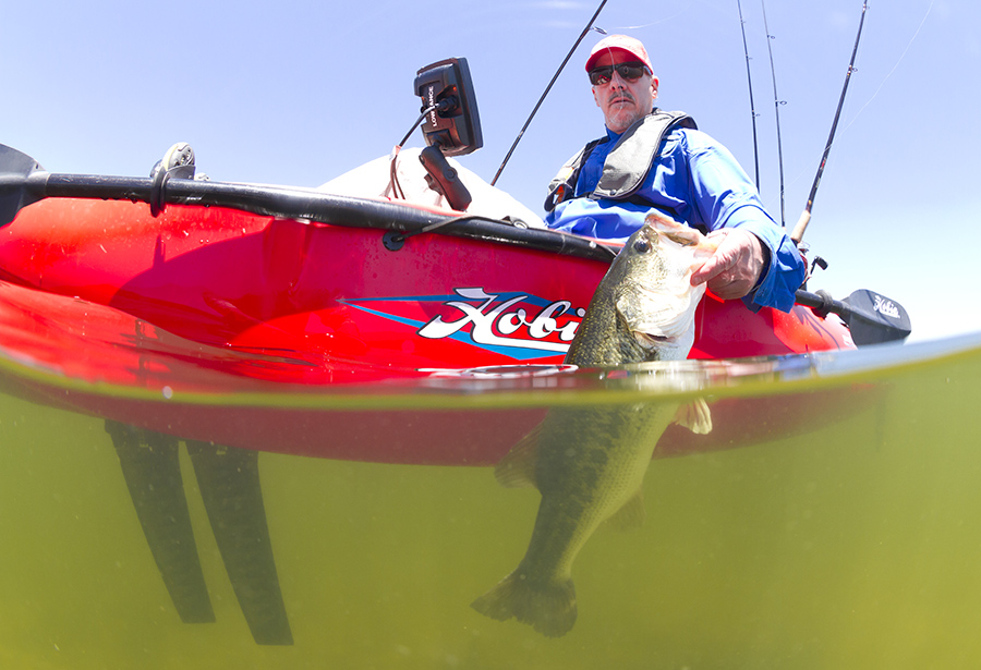 Cal lands a largemouth bass from the new Mirage Sport.