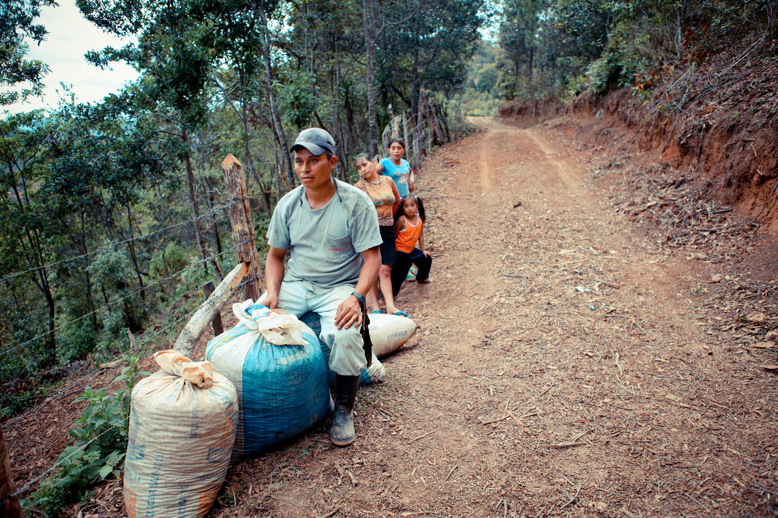 Catracha farmers with part of their yearly harvest. Many farmers in the group are very small producers, like this woman.