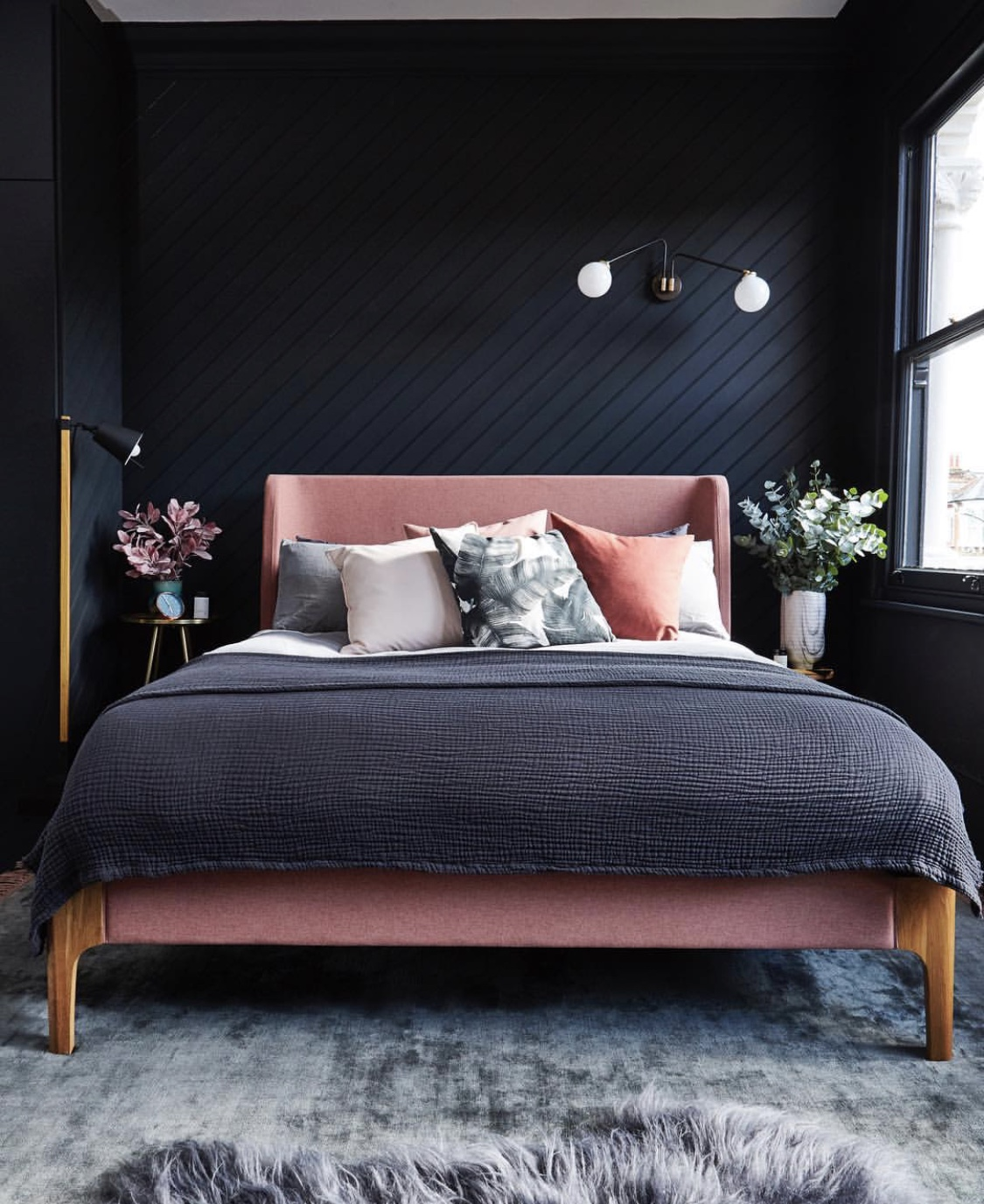 black walls and pink bed