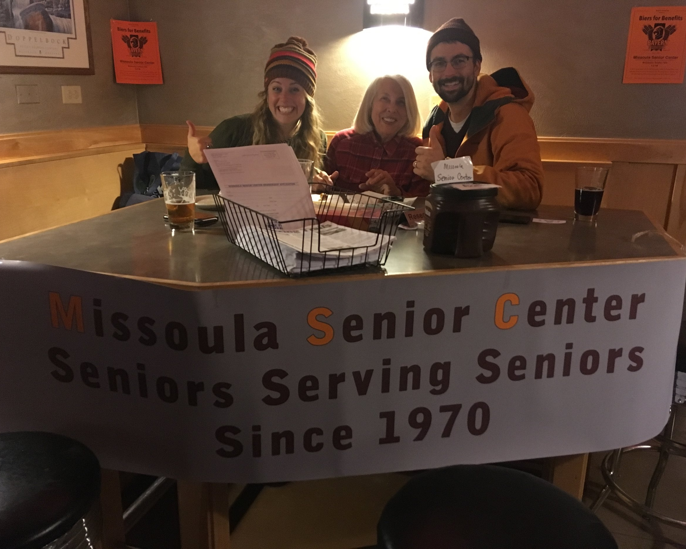 Julie Devlin and family hold down the MSC Promotional Table at a recent Biers for Benefits at Bayern Brewing. 20% of sales from beer and pretzel bites went to MSC. Thanks Bayern!
