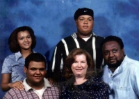 Phillip Alan shown in upper right with family.