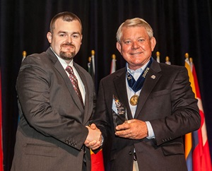 Ryan Hubbs, CFE, accepts the award from ACFE President and CEO Jim Ratley, CFE.