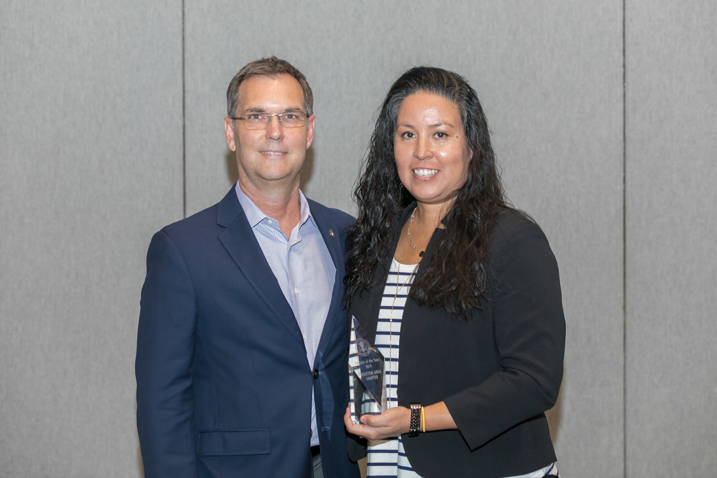 ACFE President Bruce Dorris presenting the Chapter of the Year Award to Houston Area Chapter President Chrysti Ziegler.