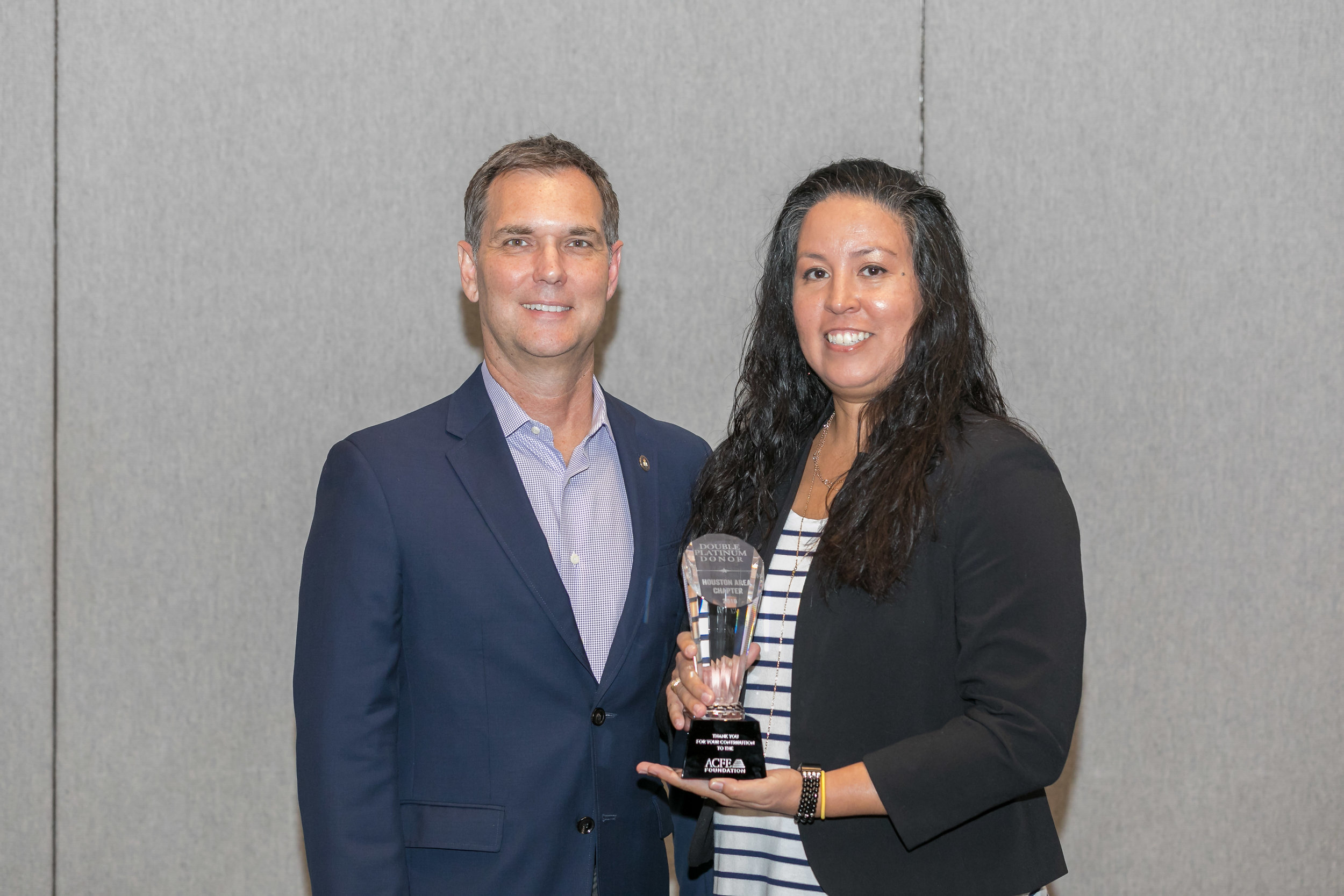 ACFE President Bruce Dorris awarding the Foundation Award to Chrysti Ziegler, Houston Area Chapter President.