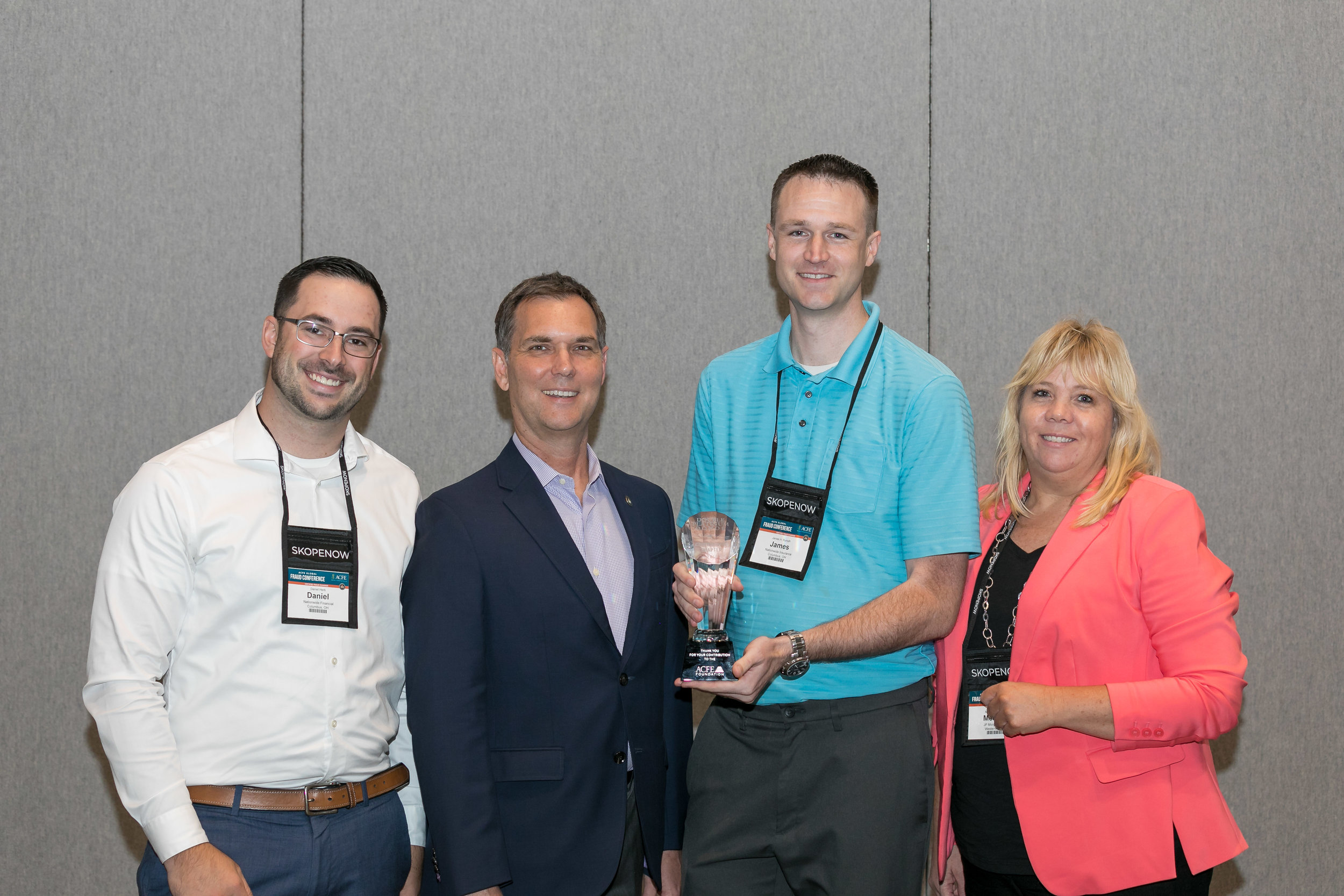 ACFE President Bruce Dorris awarding the Foundation Award to Central Ohio Chapter Leaders Daniel Herb, James Rumph, and Melissa Butsko.