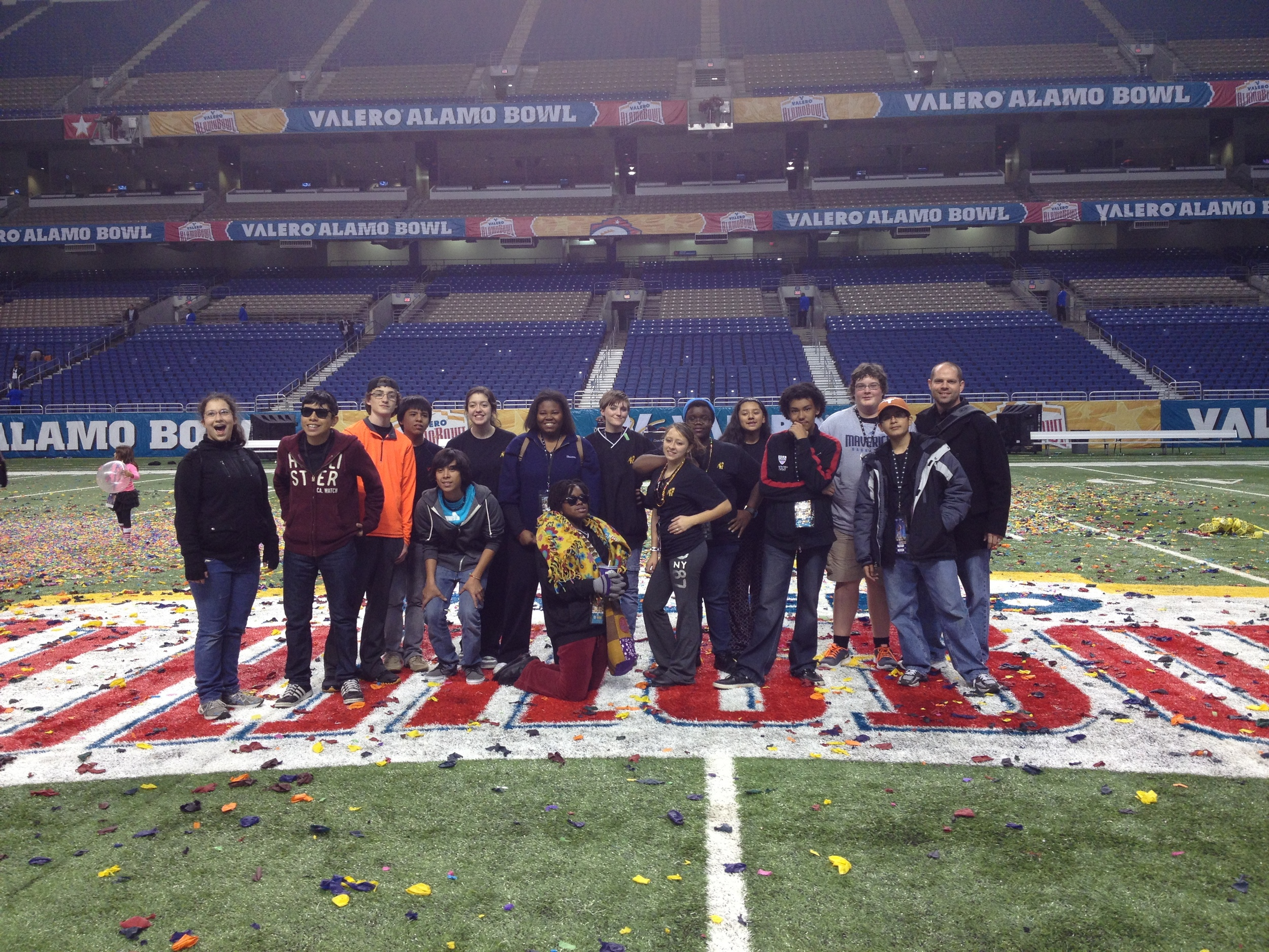 Members of the AHHS Band strike a pose on the field of the Alamo Bowl