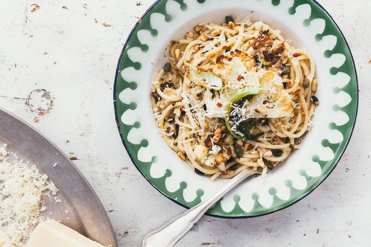 spaghetti with roasted cauliflower, currants, pine nuts, chile and sardines via millys-kitchen.com