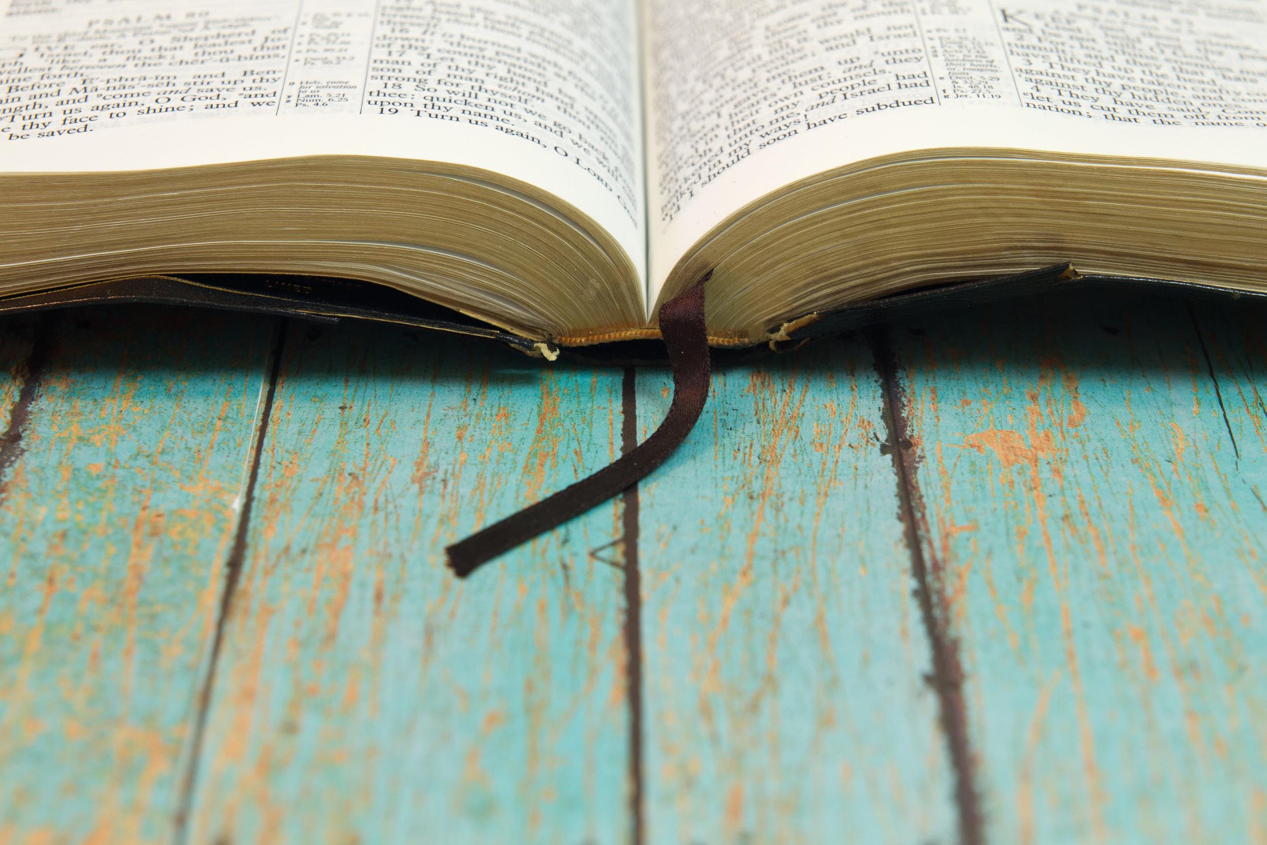 bible on teal wood.jpeg