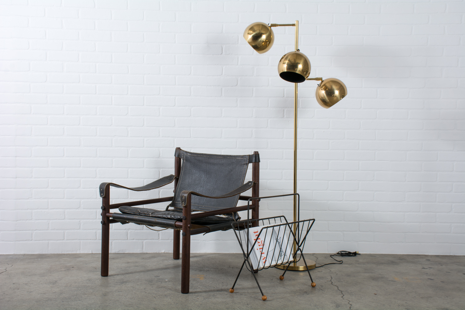 Arne Norell Vintage Mid-Century 'Sirocco' Safari Chair, Mid-Century Modern Tony Paul Magazine Rack, and Mid-Century Brass Floor Lamp by Koch & Lowy