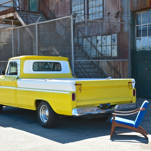 Yellow_GMC_Truck_with_Mid-Century_Lounge_Chair.jpg