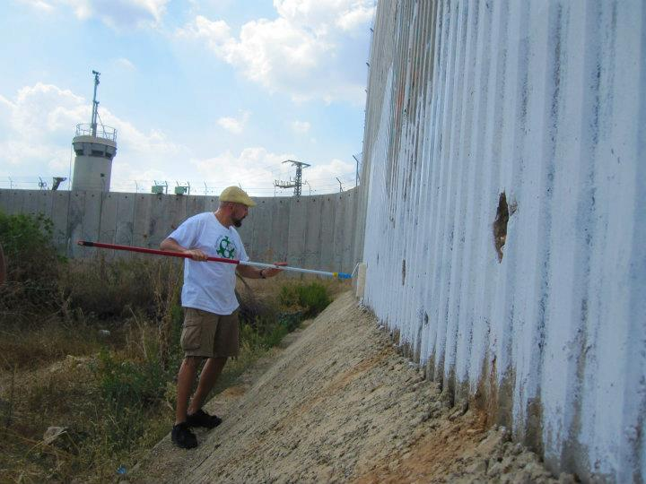 Laying out a Peace mural on the security wall in Qalqilya, Palestine