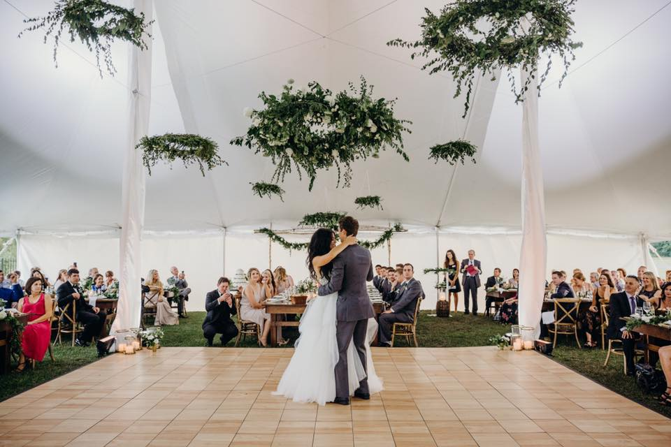 Floral chandeliers over first dance
