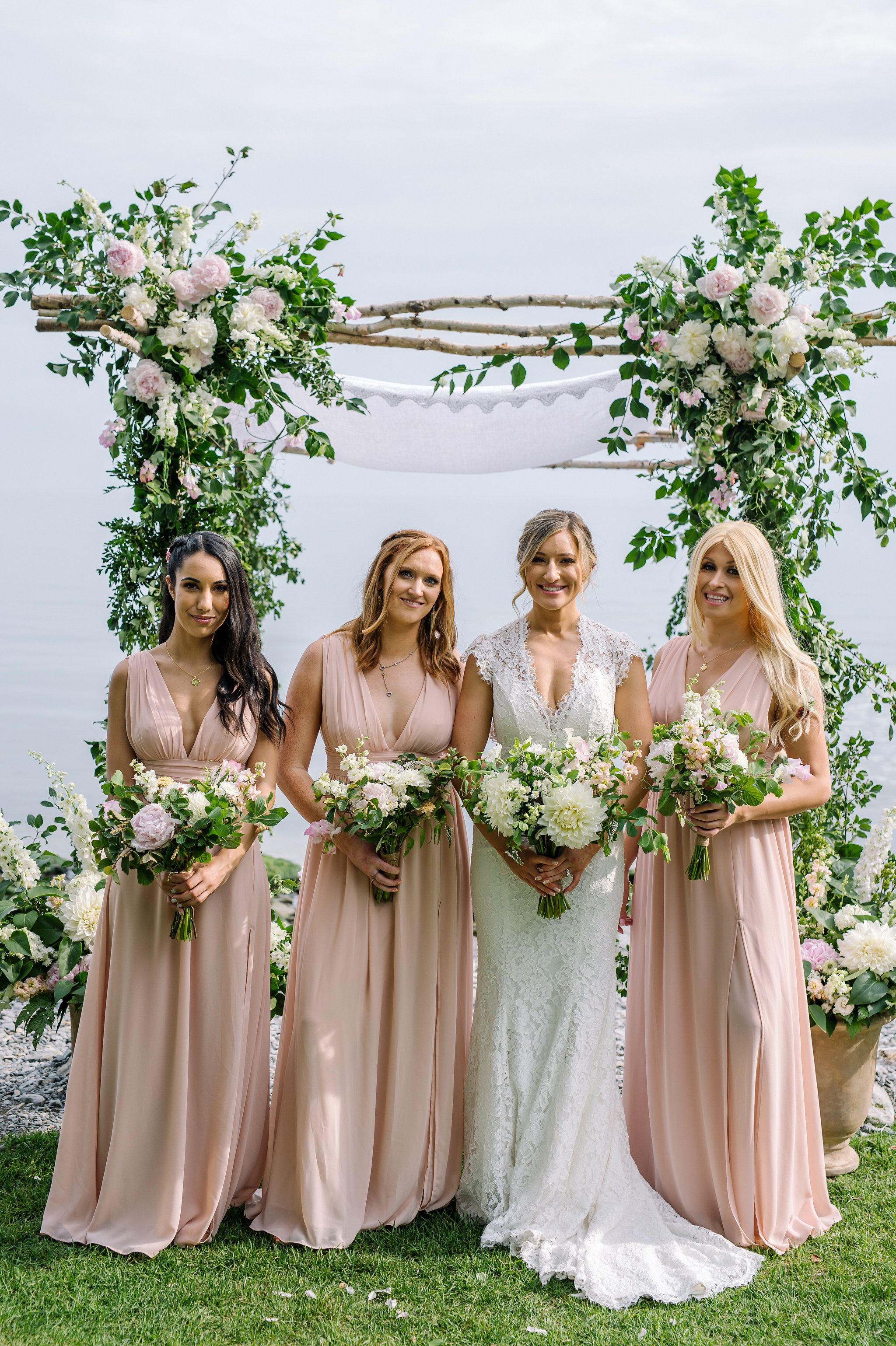 White and blush chuppah and Bridal party, waterfront at the Drake Devonshire