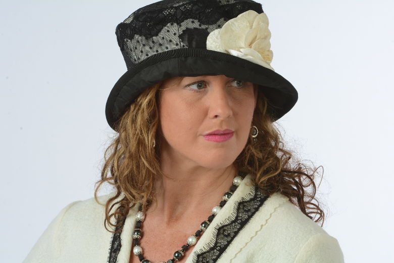 Deirdre models a vintage style hat and jacket by Plumage