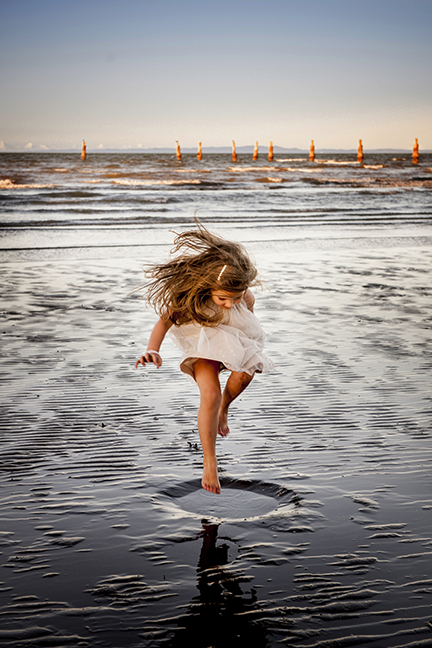A shot from an old favorite spot near Brisbane, Shorncliffe Jetty. The perfect moment.. though her Mum wasn't impressed with getting her dress dirty.. until she saw the images!