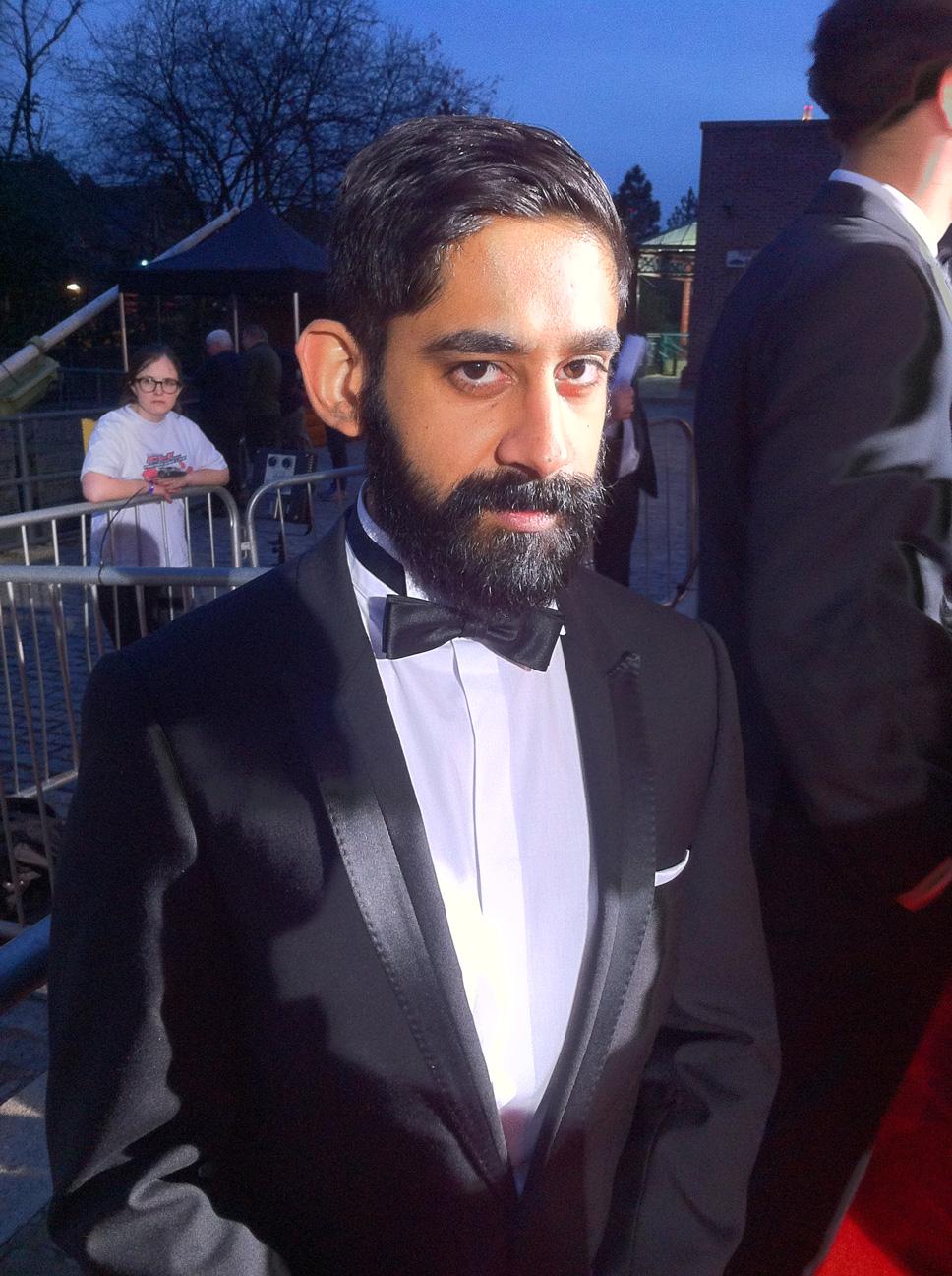 Manesh striking a pose on the red carpet on BAFTA night