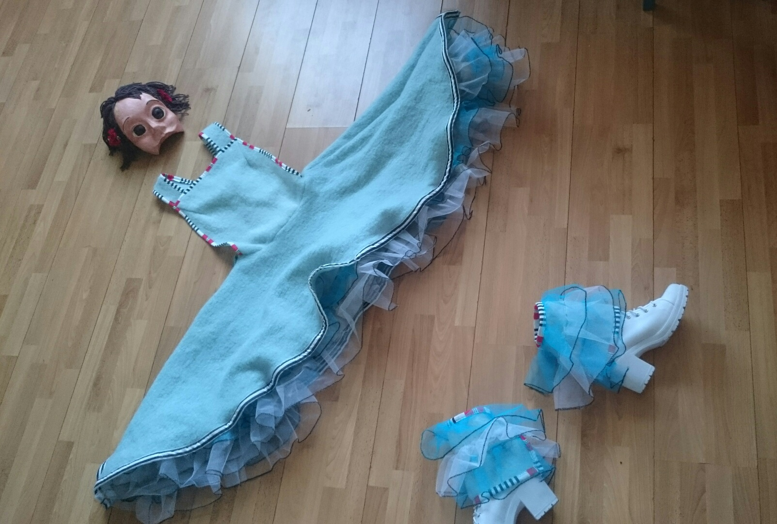 Origional costume by Cherry Head, half mask by Monika Solheim