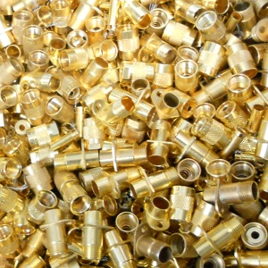 Image of batch of gold connectors, one form of electronic scrap contacts, pins and meltables Specialty Metals refines and recycles for precious metals.