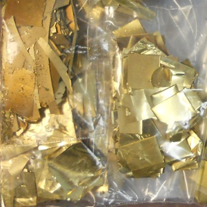 Photo of gold plated scrap, gold leaf and other gold alloy our customers have shipped to Specialty Metals for recycling and refining.