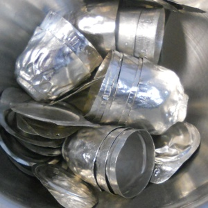 Photo of platinum crucible scrap containing platinum alloy, which  Specialty Metals Smelters and Refiners can recycle for your company.
