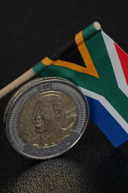 Image: A platinum version of a Nelson Mandela coin could raise platinum prices, benefitting platinum refining customers of Specialty Metals.