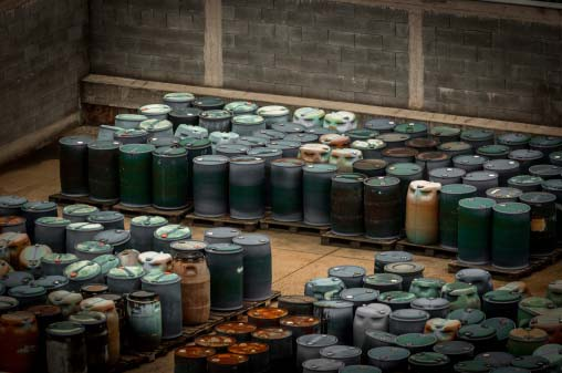 Photo of skids of drums filled used manufacturing fluids containing traces of precious metals that can be recycled profitably by Specialty Metals.