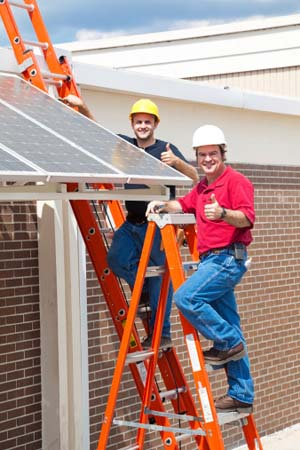 Photo of workers replacing old solar panels, which contain more silver, with newer ones. Don't miss the opportunity to recycle them profitably with Specialty Metals.