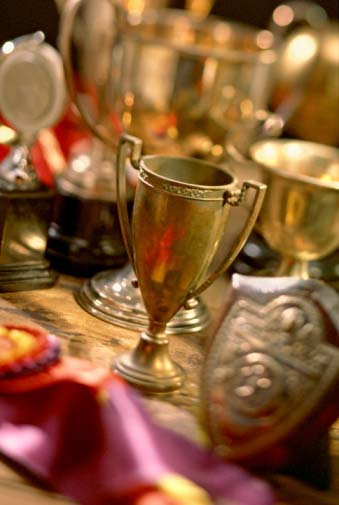 Photo of old gold-plated commemorative trophies that can be recycled and refined by Specialty Metals Smelters & Refiners.