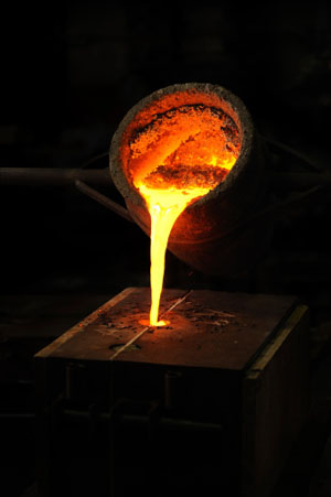 Photo of molten precious metal like platinum, silver and gold being smelted and refined - Specialty Metals Smelters & Refiners.