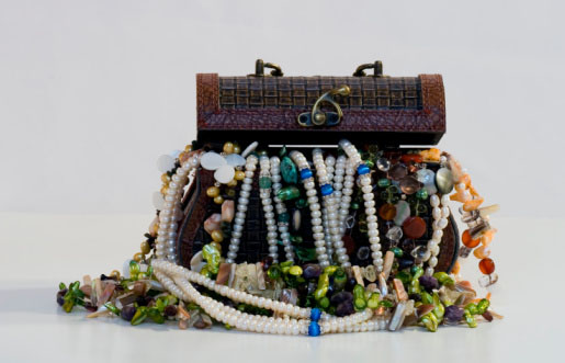 Shown: a box of costume jewelry from an inherited estate that could be hiding valuable karat gold and other precious metals.