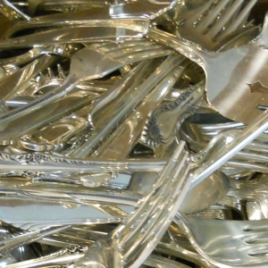 Many of our customers send us sterling silver flatware, silver-plated tableware and hollowware as shown above for us to refine and recycle.