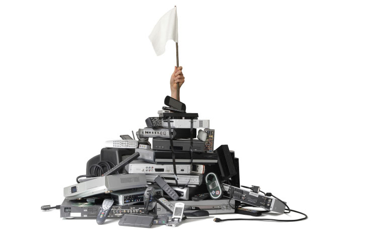 Photo of scrap remote control devices and electronics, which contain gold, silver, and platinum which Specialty Metals can help you recycle profitably.