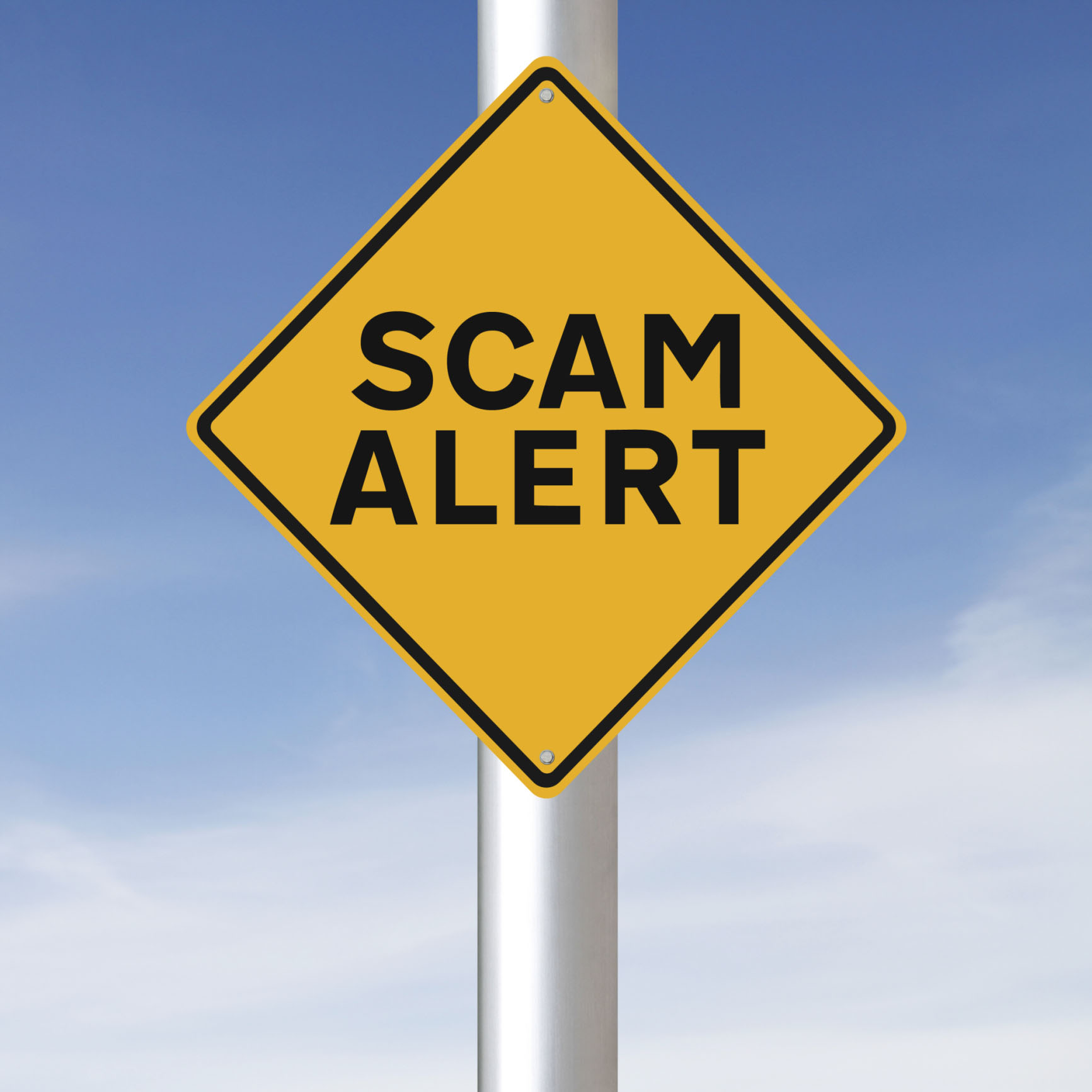 Photo of a scam alert sign, used for a blog post about avoiding precious metal scams by using a reputable recycler like Specialty Metals. Credit: amanalang/iStock/Thinkstock.