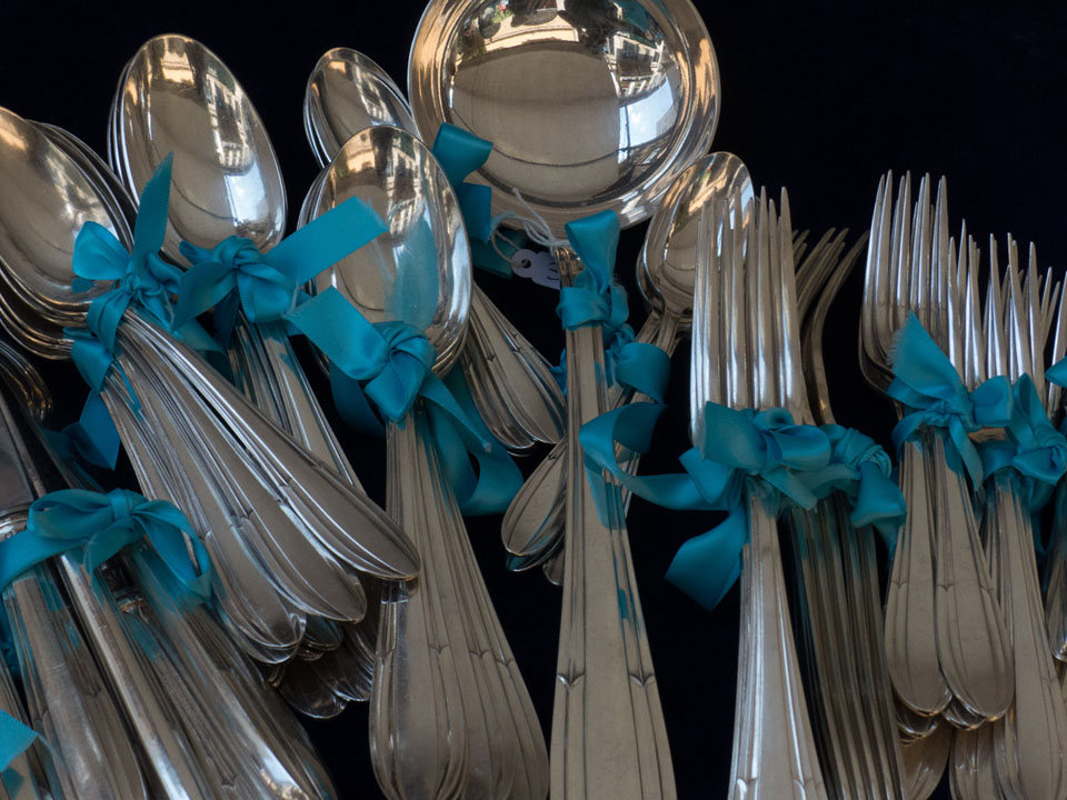 Experienced Silver-Hunters look for sterling silver spoons and forks like these at estate, garage and driveway sales. Credit: MartinPBGV/iStock