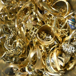 Image of an assortment of karat gold jewelry scrap, which Specialty Metals can recycle and refine for the best prices for individuals and businesses.