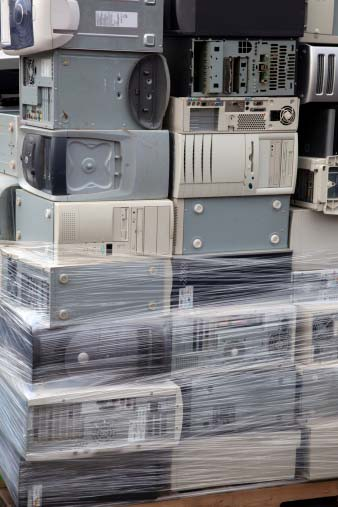 Photo of scrap computers with circuit boards containing gold, platinum and other precious metals that can be recycled by Specialty Metals.