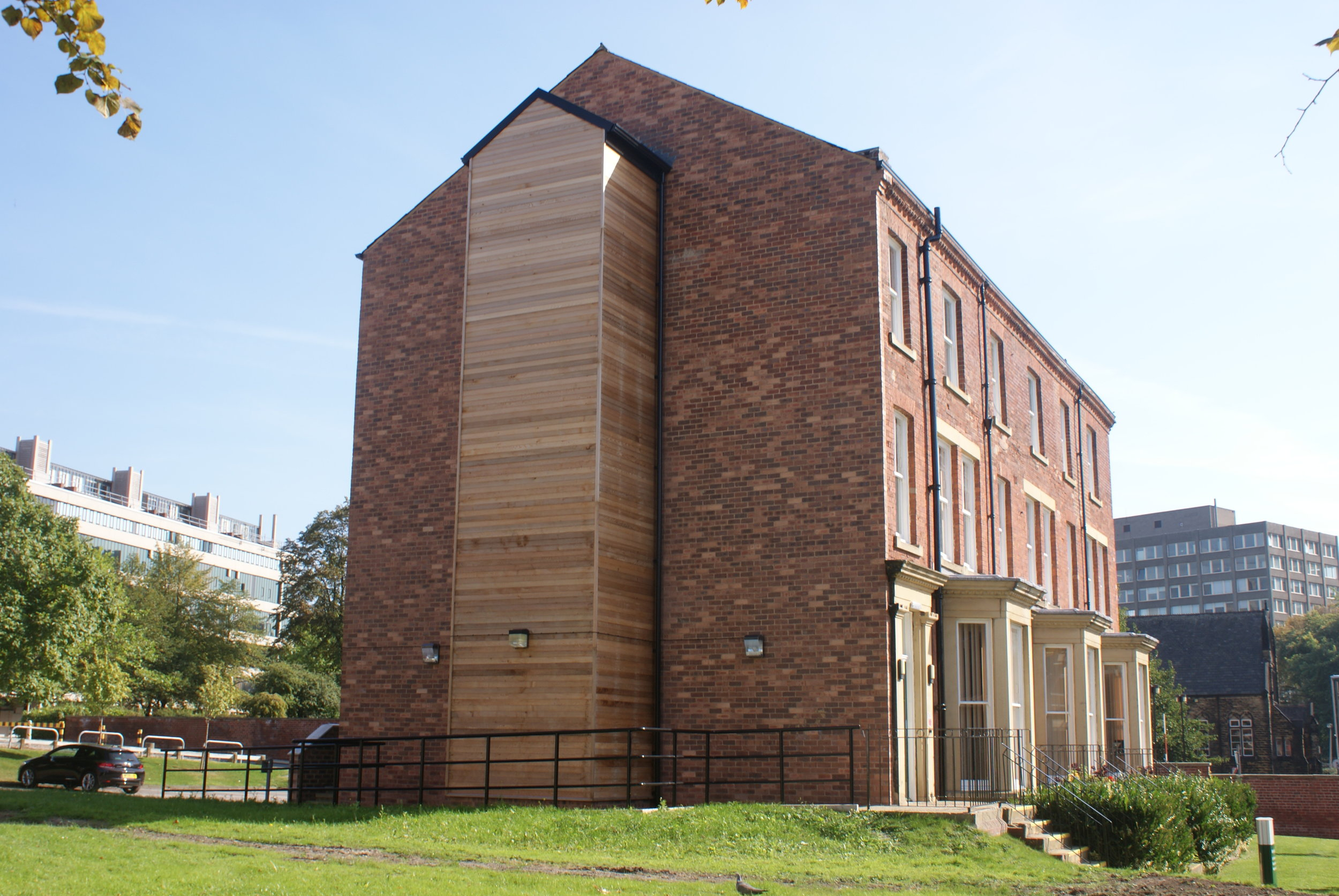 The new lift shaft was clad in cedar wood boarding to provide a contrast to the brickwork structure.