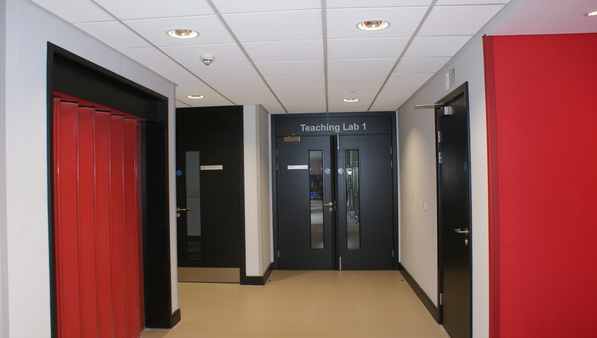 Corridor showing teaching laboratory and offices.