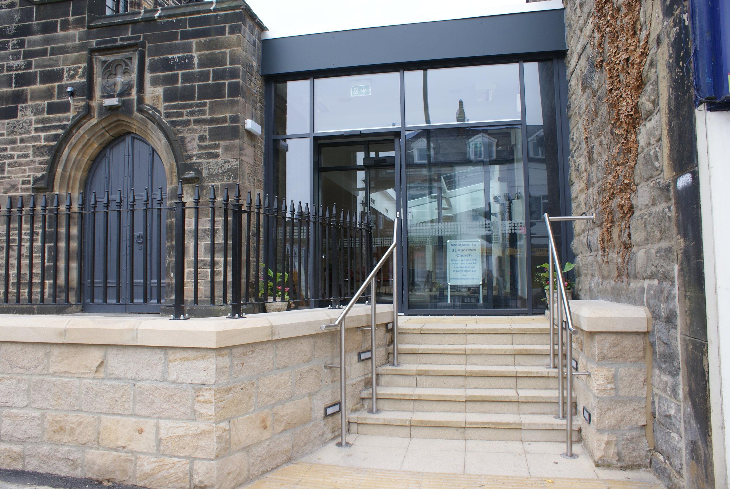 The glazed automatic entrance doors.
