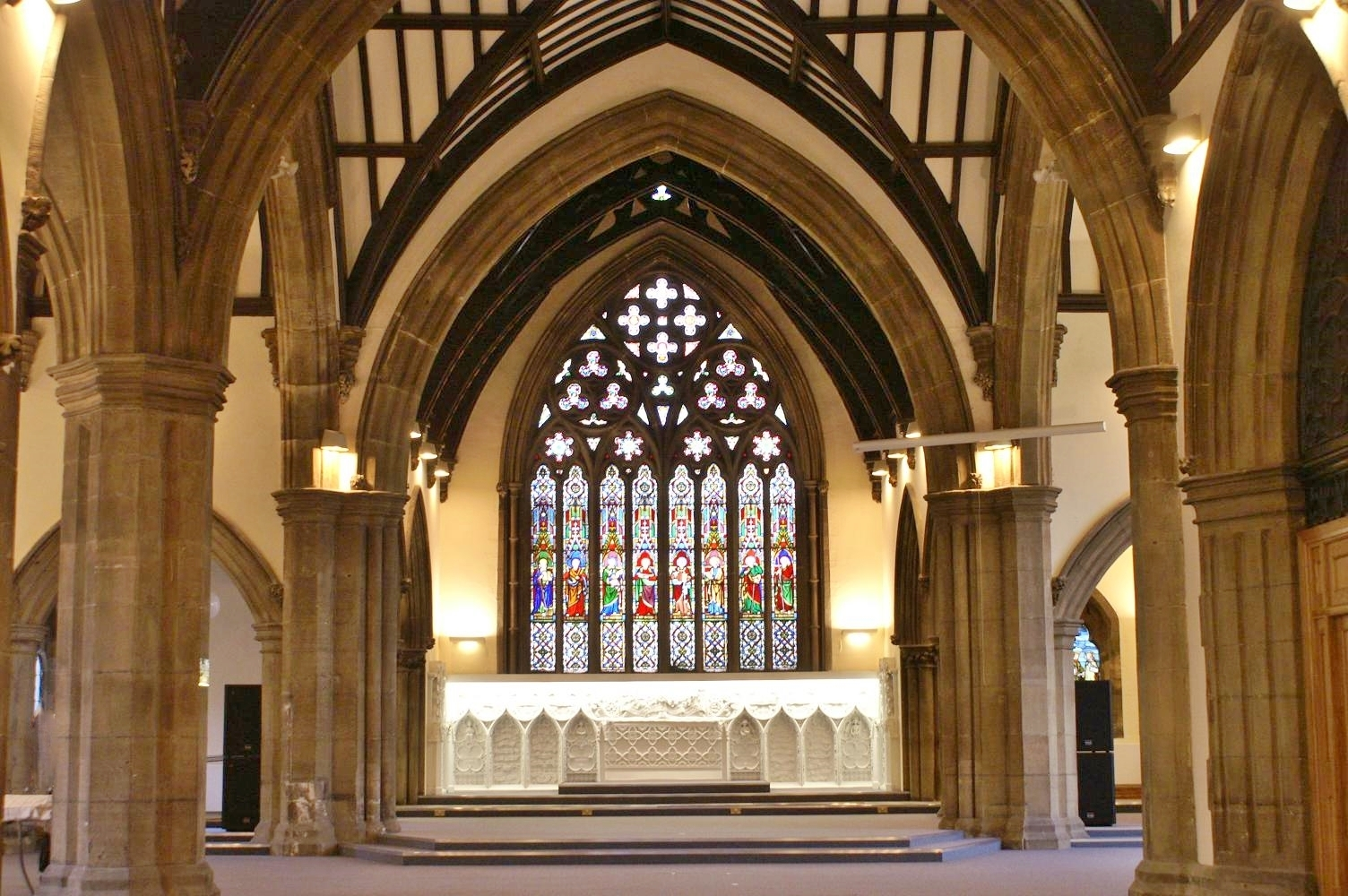 Existing stained glass window the appearance of which has been considerably enhanced by the decoration and lighting scheme