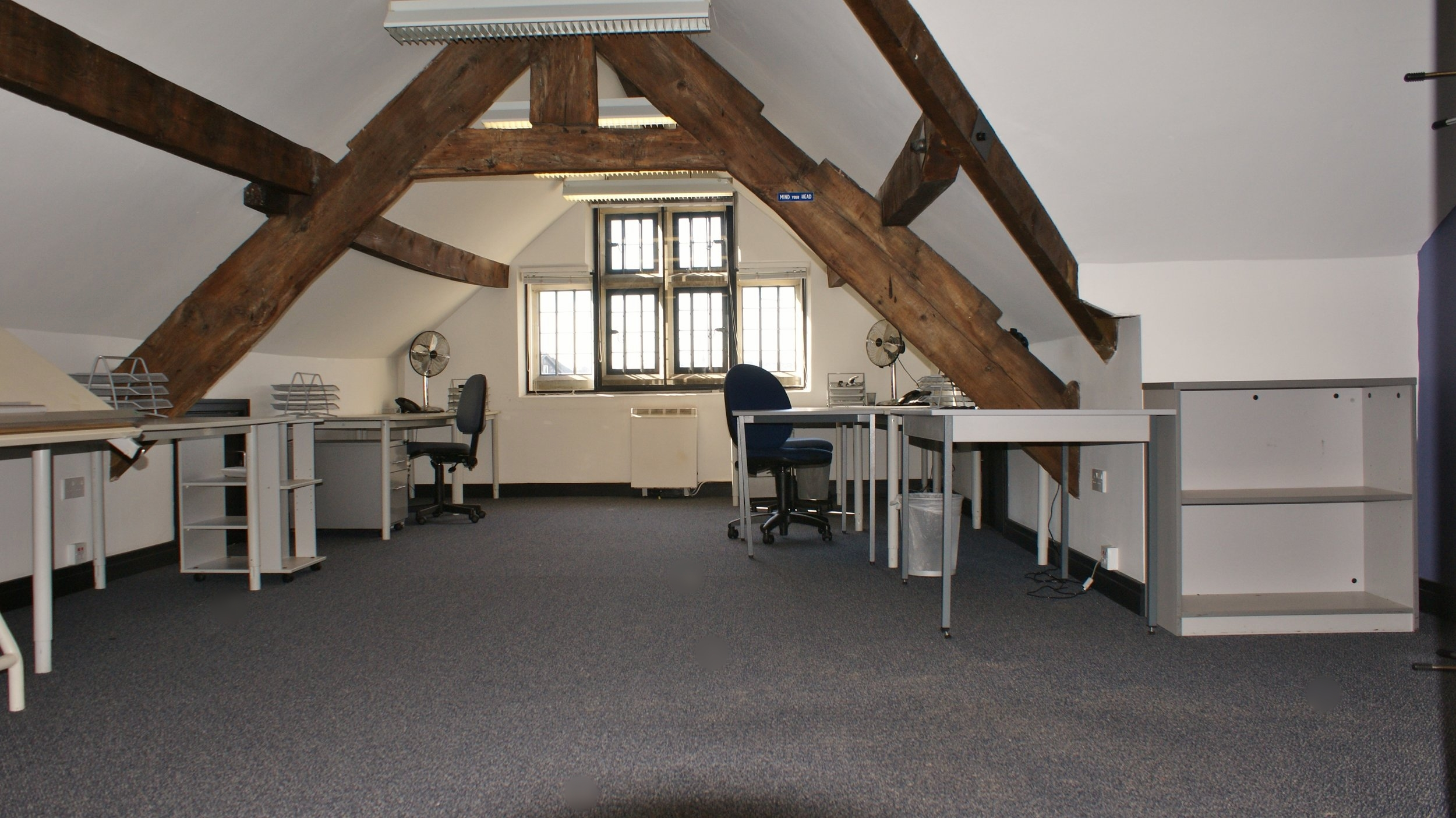 The third floor office was designed to incorporate the reduced ceiling height whilst retaining the buildings rustic features and character.