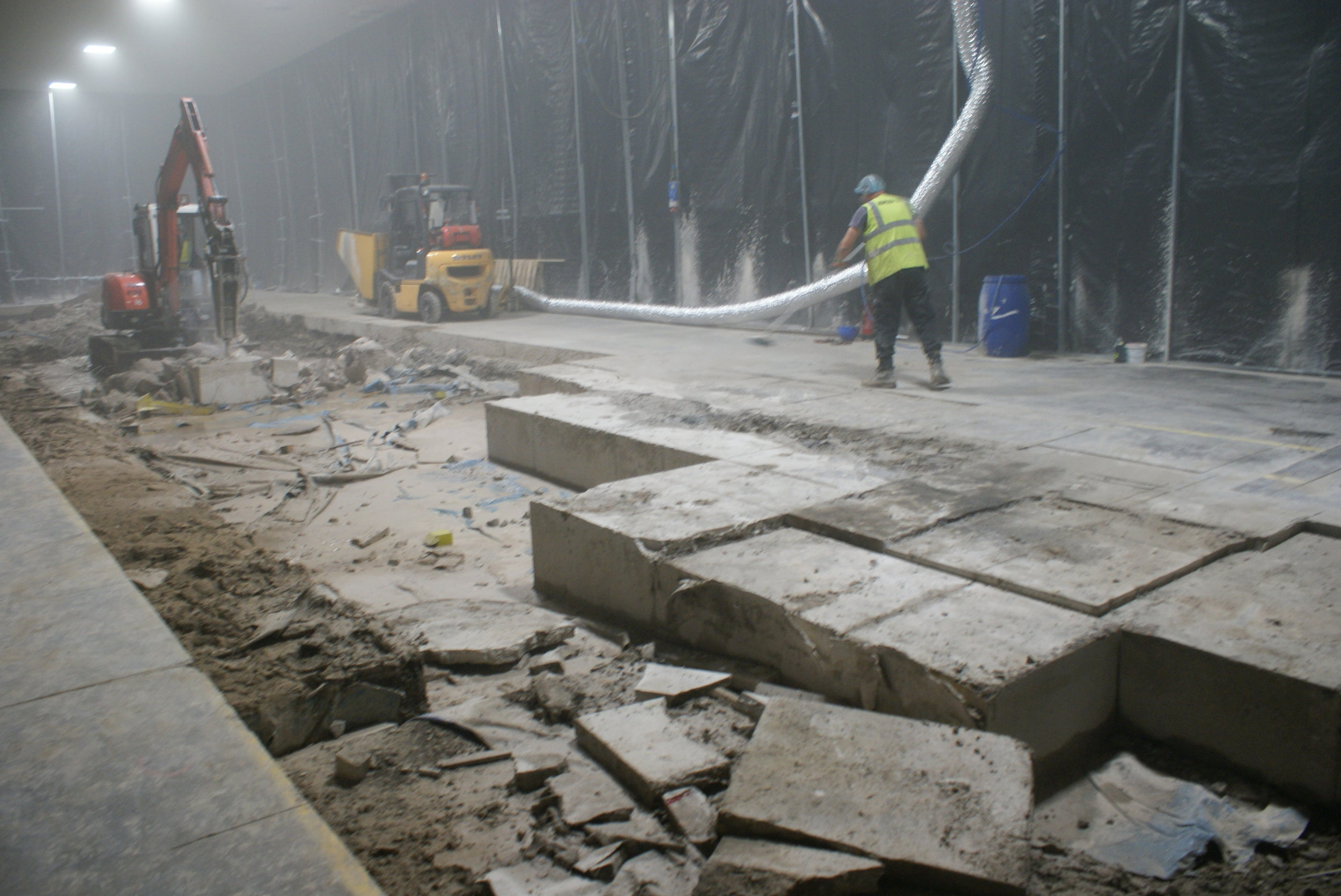 The concrete floor is cut into manageable blocks ready for removal.
