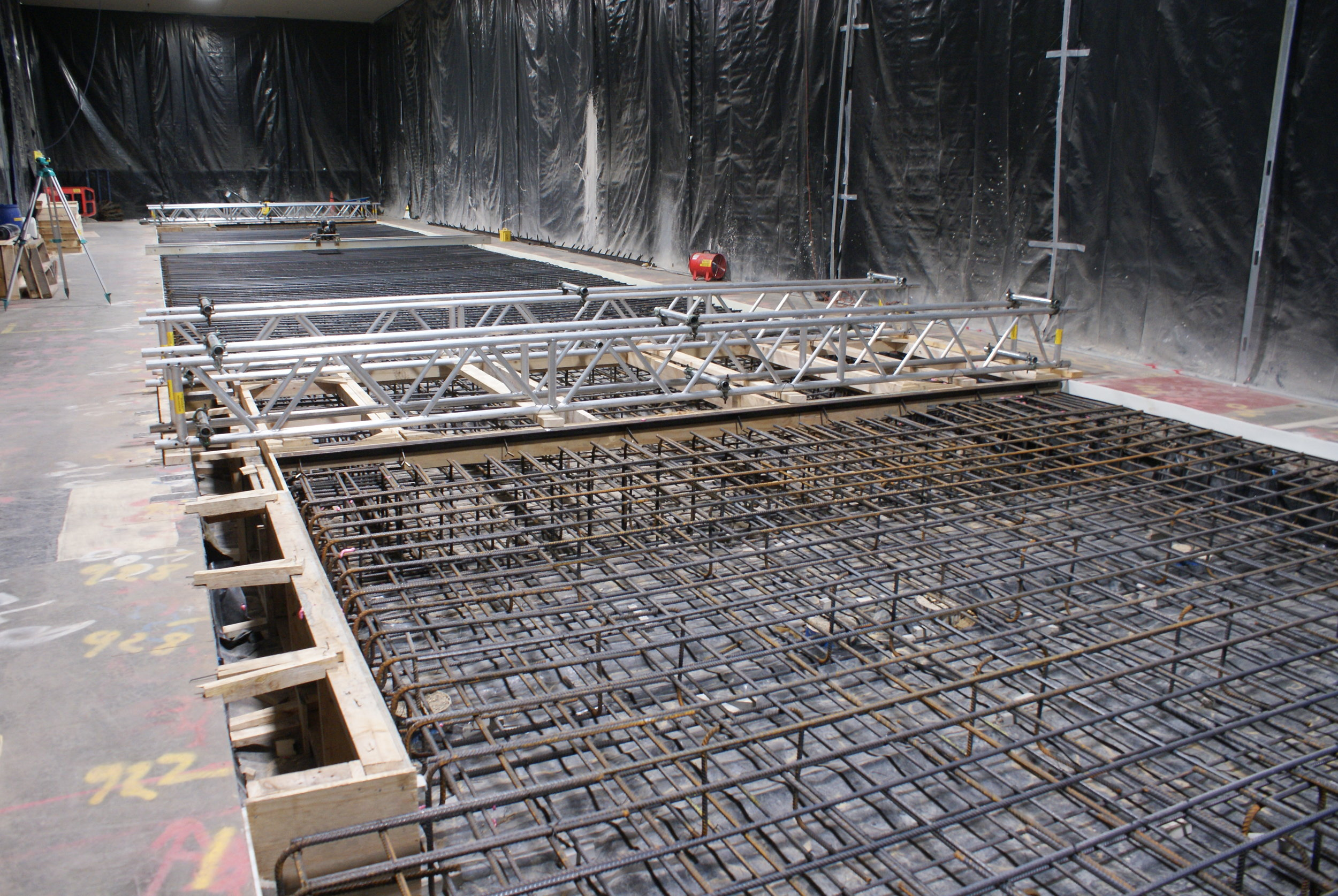 Reinforcement is connected to the pilings and then filled with concrete.