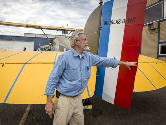 Bob-Dempster-pushes-over-the-rudder-of-The-Seattle-II-a-Douglas-World-Cruiser-replica-built-nearly-from-scratch-that-he-and-his-wife-Diane-intend-to-fly-around-the-wo.jpg