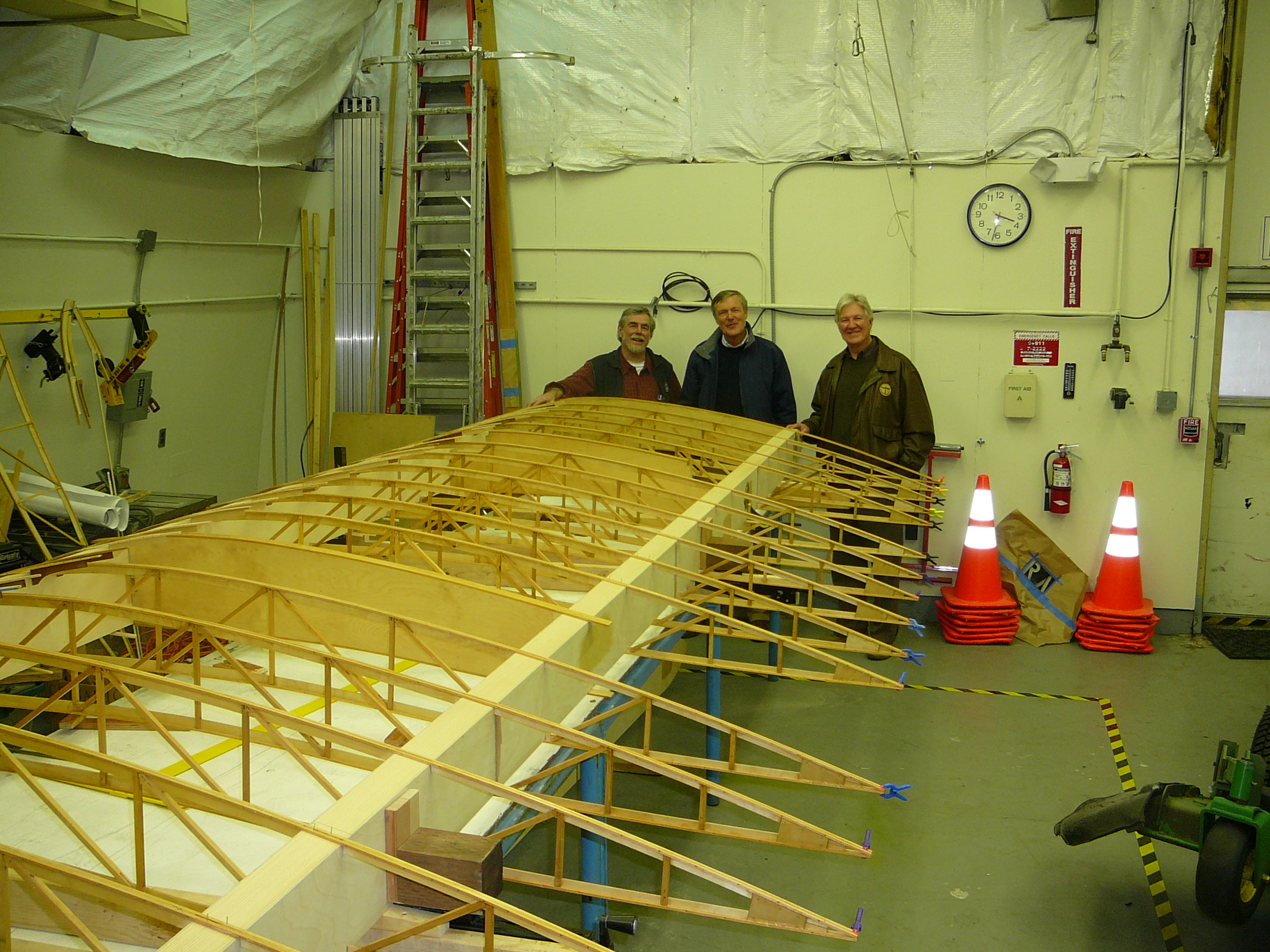 On the right: Board Director John Hope with pilot friend Dieter Hass, from Germany, admiring the bottom wing panel.