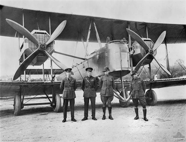 The Australian team is pictured here with their Vickers Vimy twin engine biplane. From left to right are brothers Ross and Keith Smith and their mechanics, James Bennett and Wally Shiers. The flight took 28 days to traverse the 17,911 kilometers (11,123 miles) from London to Darwin.  (Australian War Memorial)