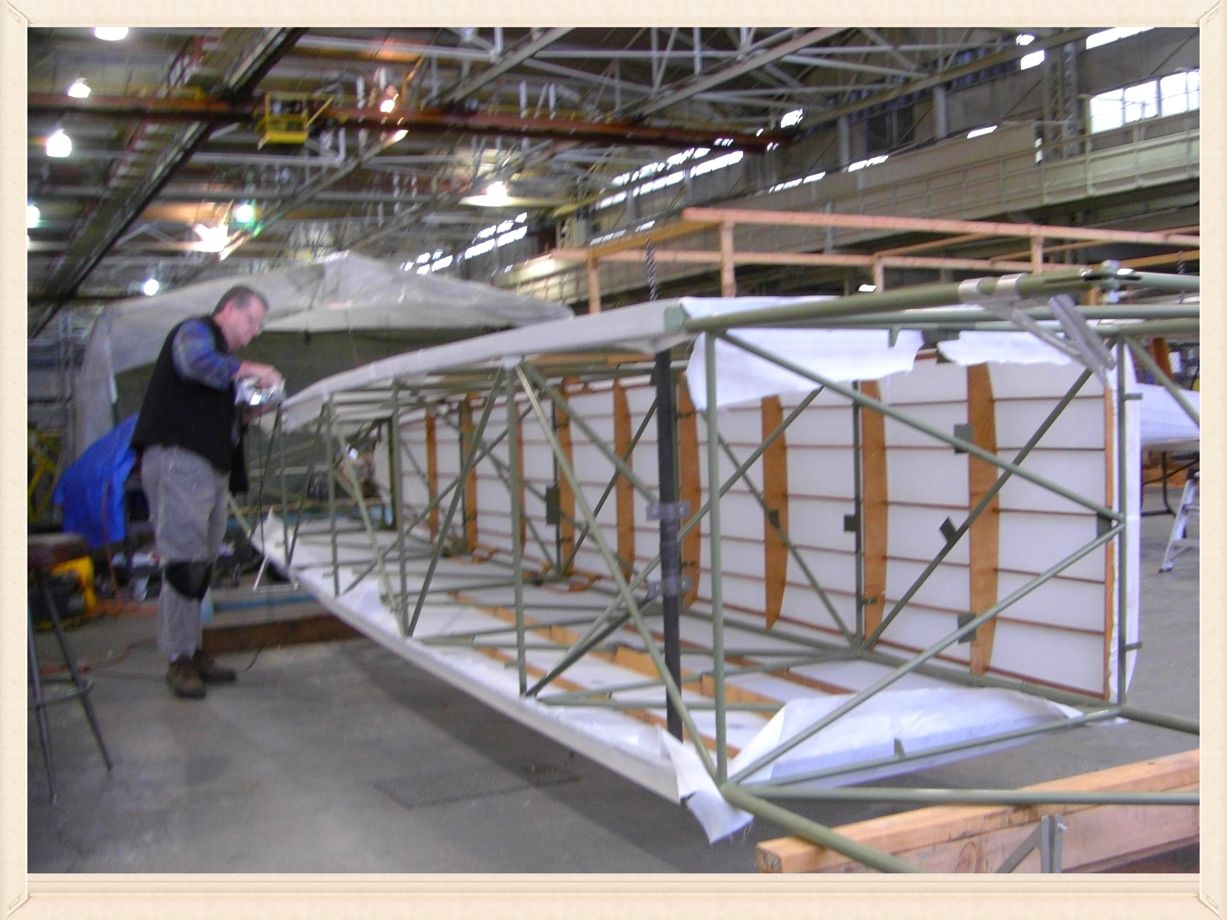 Murphy irons the fuselage fabric.